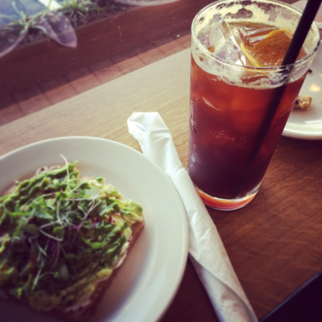 The coffee soda, with a side of avocado toast at Crema.
